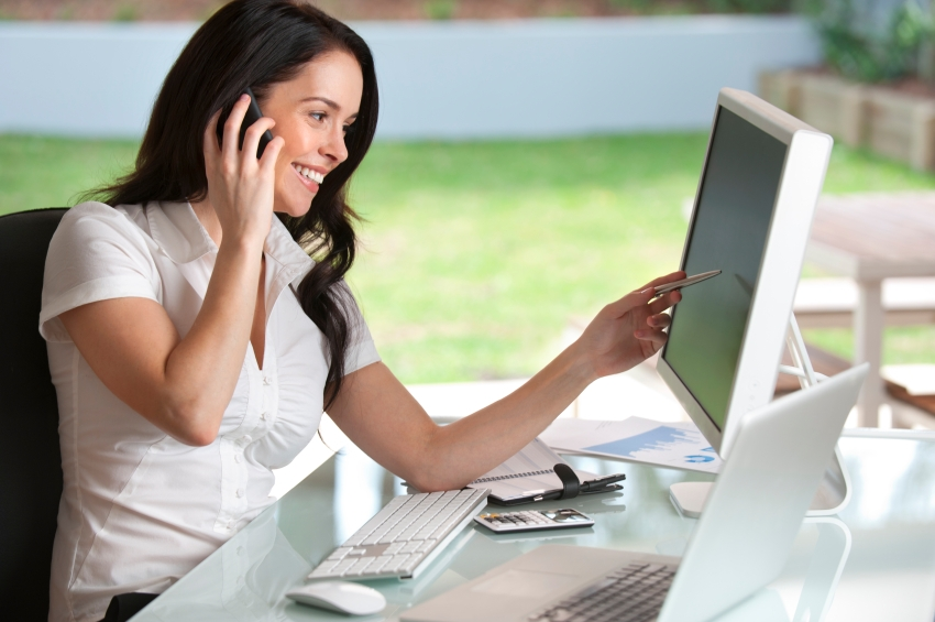 Businesswoman talking on the phone with support and smiling